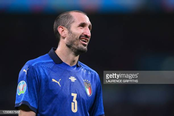 Italy's defender Giorgio Chiellini reacts during the UEFA EURO 2020 semi-final football match between Italy and Spain at Wembley Stadium in London on...