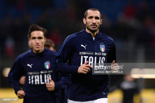 Italy's defender Giorgio Chiellini warms up prior to the UEFA Nations League group 3 football match Italy vs Portugal at the San Siro Stadium in...