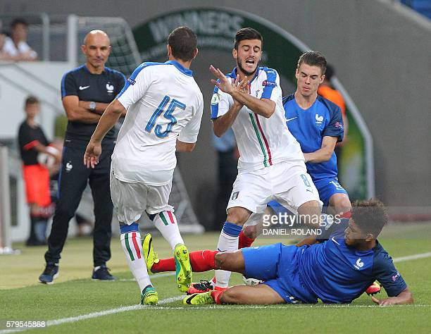 Italy's defender Giuseppe Pezzella Italy's midfielder Alberto Picchi and France's midfielder Denis Will Poha vie for the ball during the Under 19...