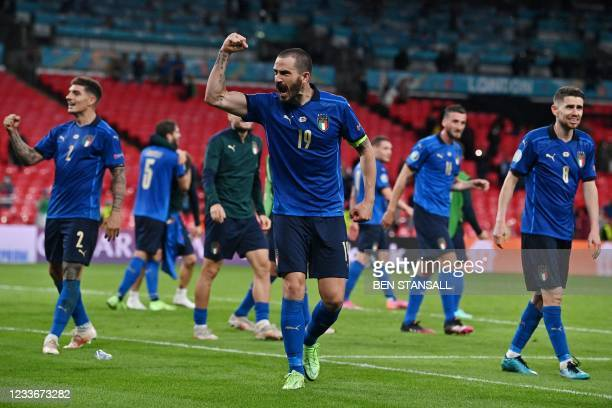Italy's defender Leonardo Bonucci and teammates celebrate their win after extra-time in the UEFA EURO 2020 round of 16 football match between Italy...