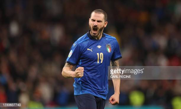 Italy's defender Leonardo Bonucci celebrates after scoring in a penalty shootout during the UEFA EURO 2020 semi-final football match between Italy...