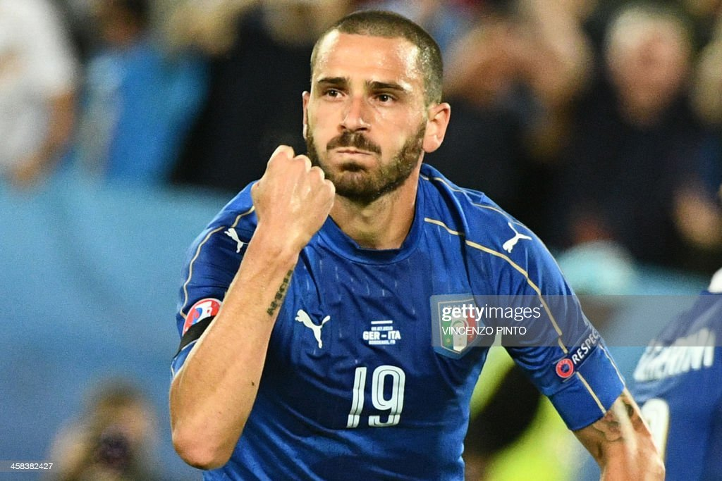 TOPSHOT - Italy's defender Leonardo Bonucci celebrates scoring a penalty shot giving Italy their first goal of the match during the Euro 2016 quarter-final football match between Germany and Italy at the Matmut Atlantique stadium in Bordeaux on July 2, 2016. PINTO