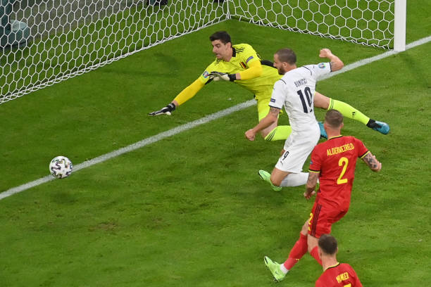 Italy's defender Leonardo Bonucci guides the ball past Belgium's goalkeeper Thibaut Courtois but the goal is ruled out by VAR review for offside...