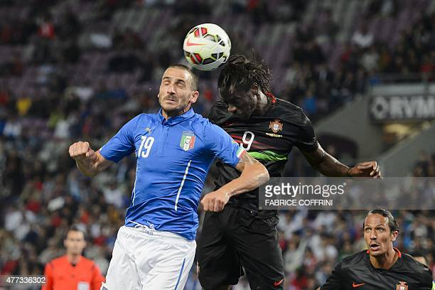 Italy's defender Leonardo Bonucci heads the ball next to Portugal's forward Eder during the friendly game Portugal against Italy at the Stade de...