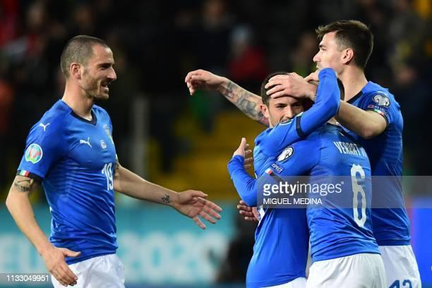 Italy's defender Leonardo Bonucci Italy's midfielder Stefano Sensi Italy's midfielder Marco Verratti and Italy's defender Alessio Romagnoli celebrate...
