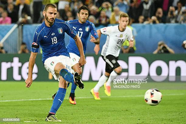 TOPSHOT Italy's defender Leonardo Bonucci shoots to score a penalty shot giving Italy their first goal of the match during the Euro 2016 quarterfinal...