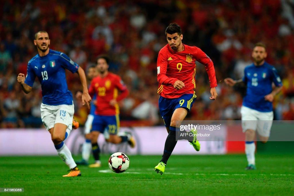 Italy's defender Leonardo Bonucci (L) vies with Spain's forward Alvaro Morata during the World Cup 2018 qualifier football match Spain vs Italy at the Santiago Bernabeu stadium in Madrid on September 2, 2017. Spain won 3-0. /
