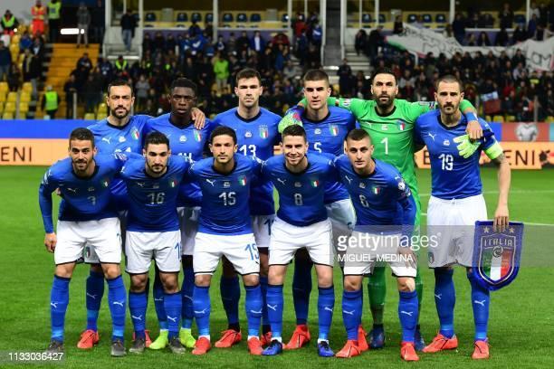 Italy's defender Leonardo Spinazzola Italy's forward Matteo Politano Italy's midfielder Stefano Sensi Italy's midfielder Jorginho and Italy's...