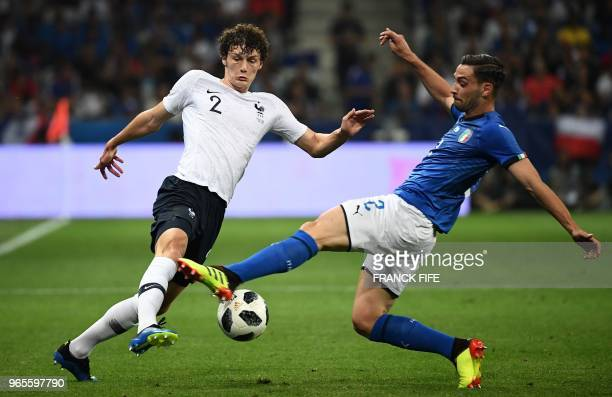 Italy's defender Mattia De Sciglio vies for the ball with France's defender Benjamin Pavard during the friendly football match between France and...