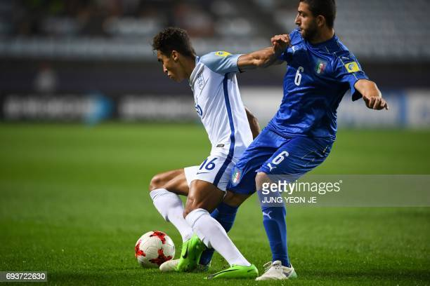 Italy's defender Mauro Coppolaro tackles England's forward Dominic CalvertLewin during the U20 World Cup semifinal football match between England and...