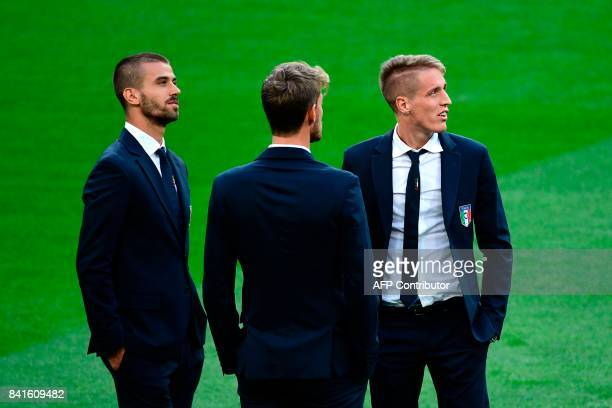 Italy's defenders Leonardo Spinazzola and Andrea Conti walk around the Santiago Bernabeu stadium in Madrid on September 1 on the eve of the World Cup...