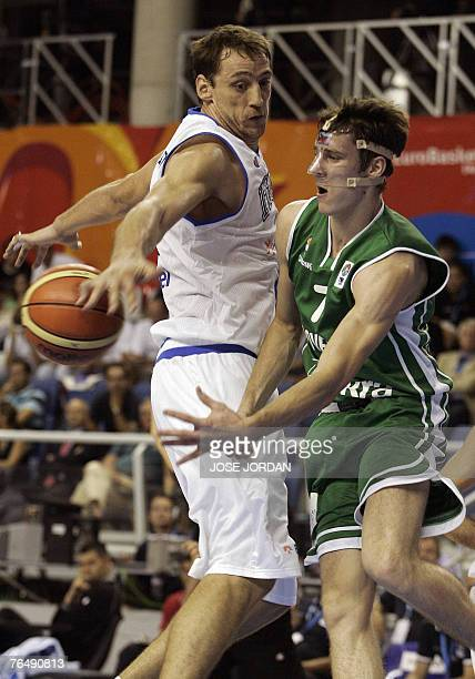 Italy's Denis Marconato vies for the ball with Slovenia's Goran Dragic during their preliminary round match at the European basketball championships...