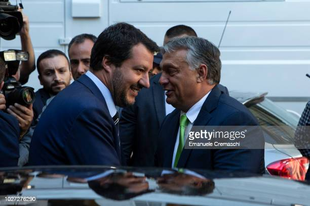 Italy's Deputy Premier and Minister of the Interior Matteo Salvini greets Hungary's Prime Minister Viktor Orban before attending a joint news...