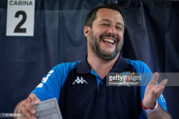 Italy's Deputy Prime Minister and leader of rightwing Lega political party Matteo Salvini holds his ballot before casting his vote for the European...