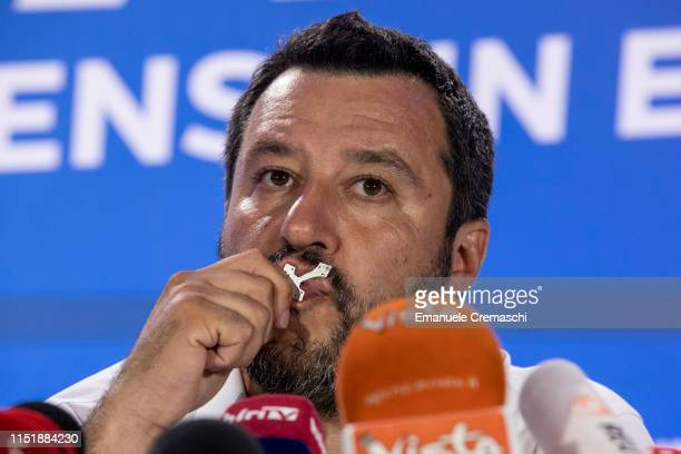 Italy's Deputy Prime Minister and leader of rightwing Lega political party Matteo Salvini kisses a crucifix while attending a news conference...