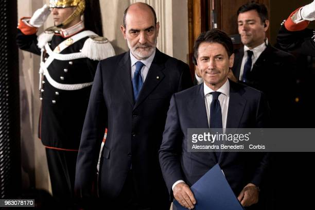 Italy's designated Prime Minister Giuseppe Conte talks to journalists after having returned the mandate to form a new government to President Sergio...