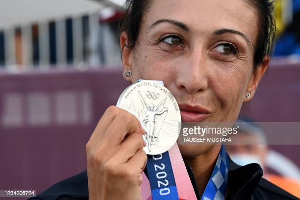 Italy's Diana Bacosi poses on the podium with her silver medal after the womens skeet final during the Tokyo 2020 Olympic Games at the Asaka Shooting...