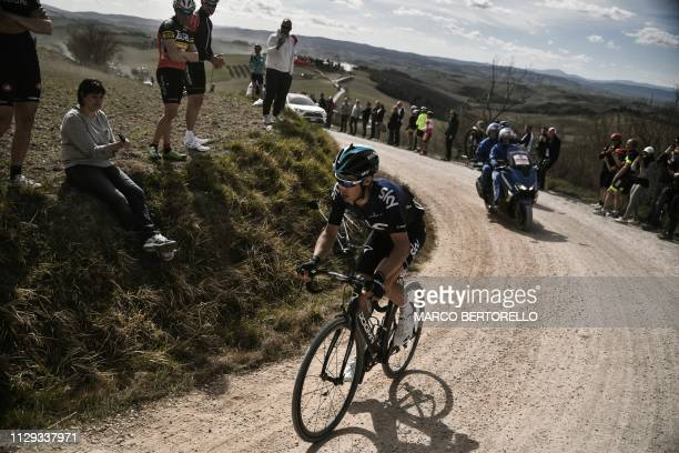 Italy's Diego Rosa rides through a gravel road during his one-man breakaway in the one-day classic cycling race Strade Bianche on March 9, 2019 in...