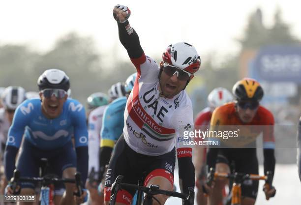 Italy's Diego Ulissi celebrates his victory as he crosses the finish line of the 13th stage of the Giro d'Italia 2020 cycling race, a 192-kilometers...
