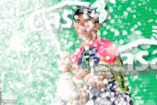 Italy's Diego Ulissi of team LampreMerida celebrates on the podium after he won the 11th stage of the 99th Giro d'Italia Tour of Italy from Modena to...