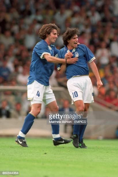 Italy's Dino Baggio congratulates goal scorer Demetrio Albertini