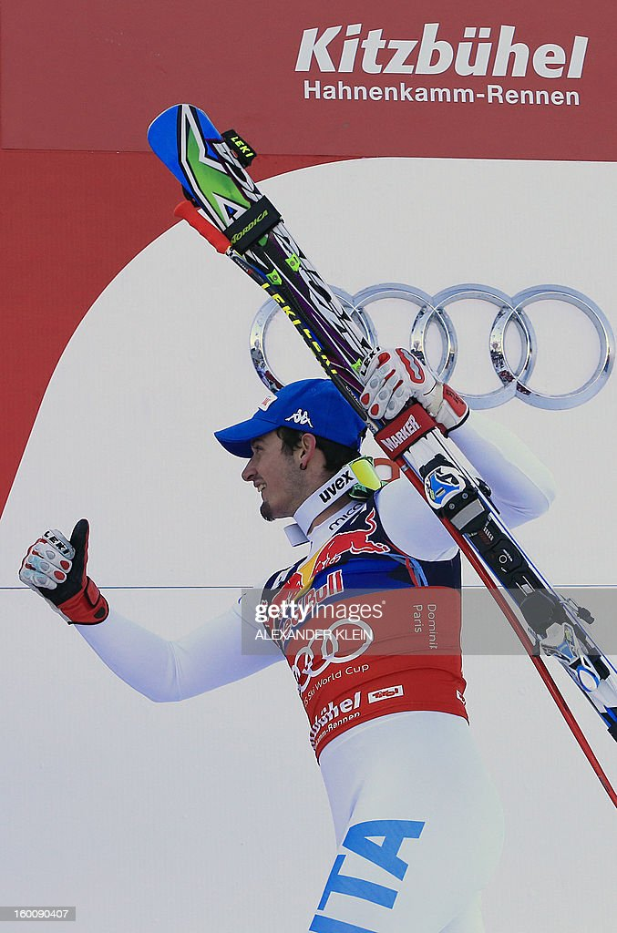 Italy's Dominik Paris arrives to celebrate on the podium after winning the FIS World Cup men's downhill race on January 26, 2013 in Kitzbuehel, Austrian Alps.