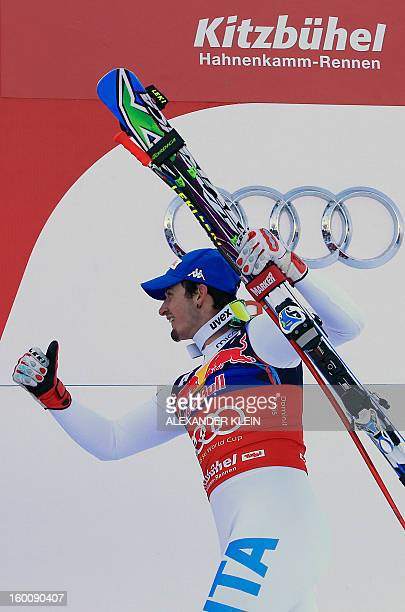 Italy's Dominik Paris arrives to celebrate on the podium after winning the FIS World Cup men's downhill race on January 26 2013 in Kitzbuehel...