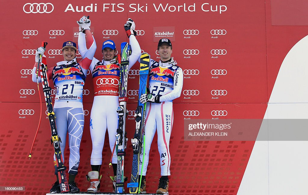 Italy's Dominik Paris (C), Canada's Erik Guay (L) and Austria's Hannes Reichelt (R) pose on the podium after the FIS World Cup men's downhill race on January 26, 2013 in Kitzbuehel, Austrian Alps. Italy's Dominik Paris won the event, Canada's Erik Guay finished second and Austria's Hannes Reichelt third.