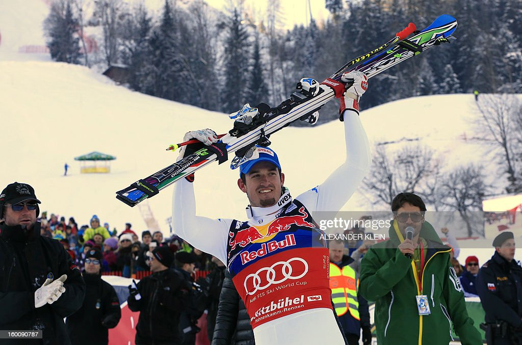 Italy's Dominik Paris (C) reacts after competing in the FIS World Cup men's downhill race on January 26, 2013 in Kitzbuehel, Austrian Alps. Italy's Dominik Paris won the event.