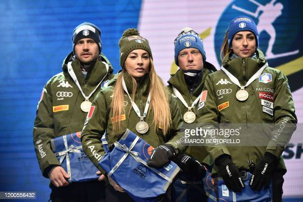Italy's Dominik Windisch, Italy's Dorothea Wierer, Italy's Lukas Hofer and Italy's Lisa Vittozzi pose with their silver medal on the podium after...