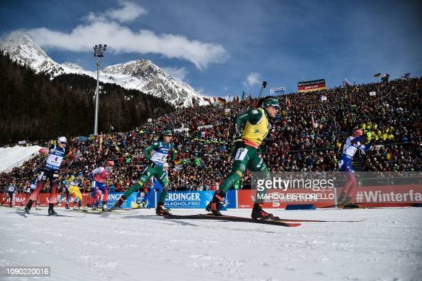 Italy's Dorothea Wierer and athletes take the start of the women's 125 km mass start event of the IBU Biathlon World Cup in RasenAntholz Italian Alps...