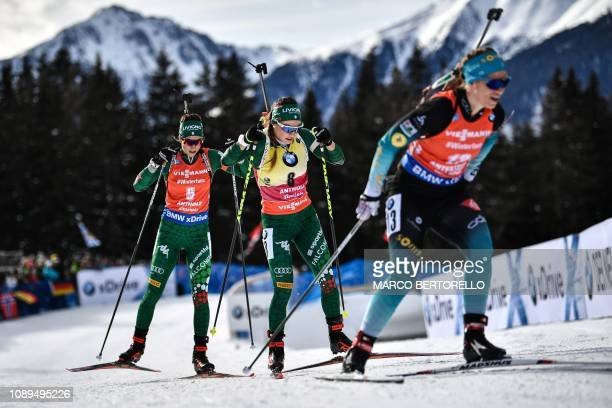 Italy's Dorothea Wierer and Italy's Lisa Vittozzi compete in the women's 10km pursuit event of the IBU Biathlon World Cup in RasenAntholz Italian...
