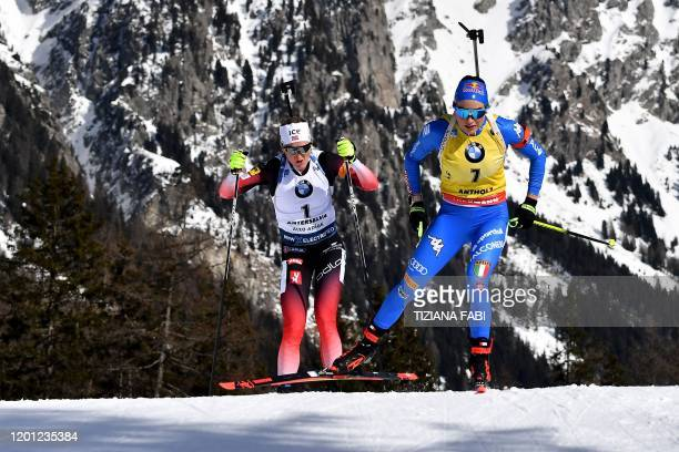 Italy's Dorothea Wierer and Norway's Marte Olsbu Roeiseland compete in the IBU Biathlon World Cup 10 km Women's pursuit in RasenAntholz Italian Alps...