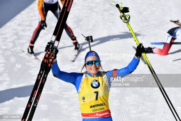 Italy's Dorothea Wierer celebrates after crossing the finish line of the IBU Biathlon World Cup 10 km Women's pursuit in RasenAntholz Italian Alps on...