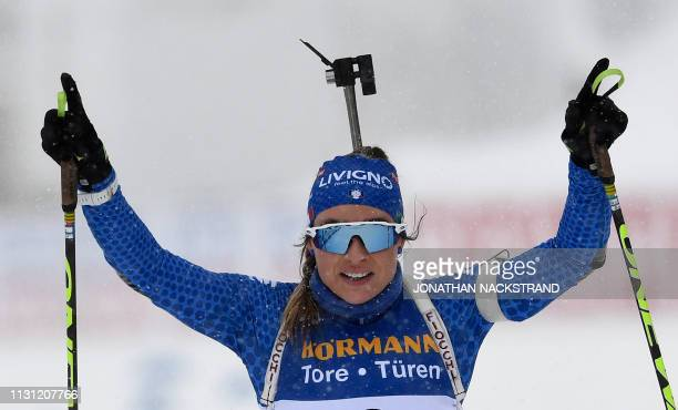 Italy's Dorothea Wierer celebrates after crossing the finish line to win the women's 12,5 km mass start event at the IBU World Biathlon Championships...