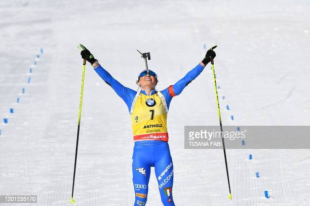 Italy's Dorothea Wierer celebrates as she crosses the finish line of the IBU Biathlon World Cup 10 km Women's pursuit in RasenAntholz Italian Alps on...