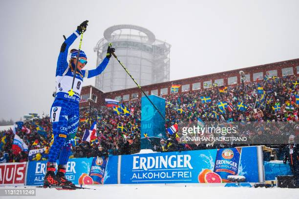 Italy's Dorothea Wierer celebrates as she crosses the finish line to win the women's 125 km mass start event at the IBU World Biathlon Championships...