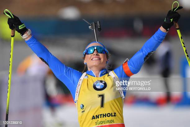 Italy's Dorothea Wierer celebrates as she crosses the finish line to win the IBU Biathlon World Cup 10 km Women's pursuit in RasenAntholz Italian...