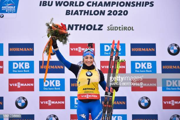Italy's Dorothea Wierer celebrates on the podium after winning the IBU Biathlon World Cup 10 km Women's pursuit in RasenAntholz Italian Alps on...