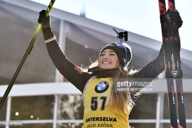 Italy's Dorothea Wierer celebrates on the podium after winning the IBU Biathlon World Cup Women's 15 km Individual Competition in RasenAntholz...
