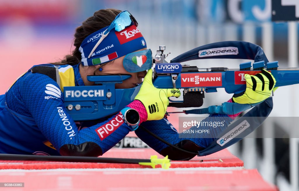 Italy's Dorothea Wierer competes at the shooting range during the women's 15 km individual event at the Biathlon World Cup on January 11, 2018 in Ruhpolding, southern Germany. Italy's Dorothea Wierer won the event ahead of Finland's Kaisa Makarainen (2nd) and Canada's Rosanna Crawford (3rd). / AFP PHOTO / dpa / Sven Hoppe / Germany OUT