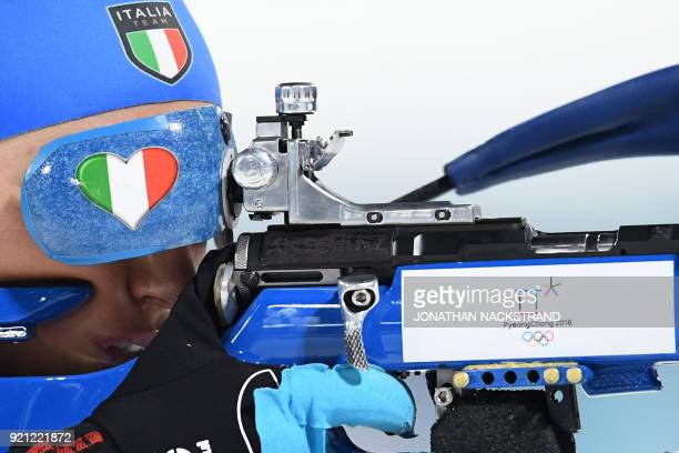 Italy's Dorothea Wierer competes at the shooting range in the mixed relay biathlon event during the Pyeongchang 2018 Winter Olympic Games on February...