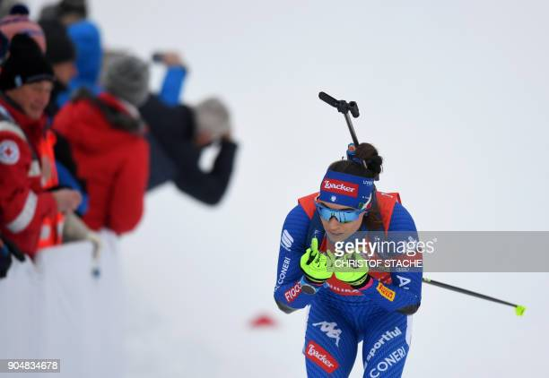 Italy's Dorothea Wierer competes during the women's 125 kilometer mass start competition at the Biathlon World Cup on January 14 2018 in Ruhpolding...