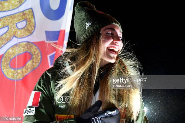 Italy's Dorothea Wierer laughs as she poses on the podium during the medal ceremony after winning the IBU Biathlon World Cup Women's 15 km Individual...