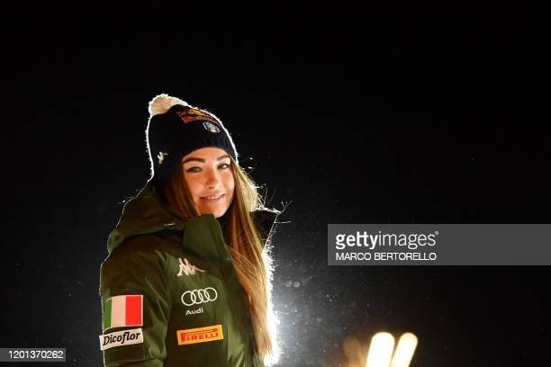 Italy's Dorothea Wierer looks poses the podium during the medal ceremony after winning the IBU Biathlon World Cup 10 km Women's pursuit in...