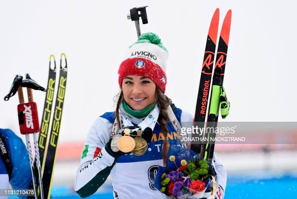 Italy's Dorothea Wierer poses with her gold medal after winning the women's 125 km mass start event at the IBU World Biathlon Championships in...