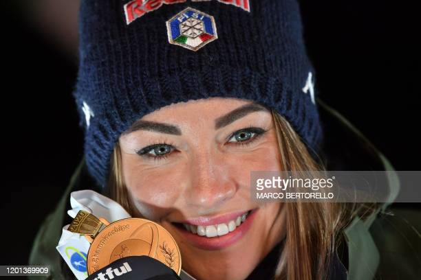 Italy's Dorothea Wierer poses with her gold medal on the podium after winning the IBU Biathlon World Cup 10 km Women's pursuit in RasenAntholz...
