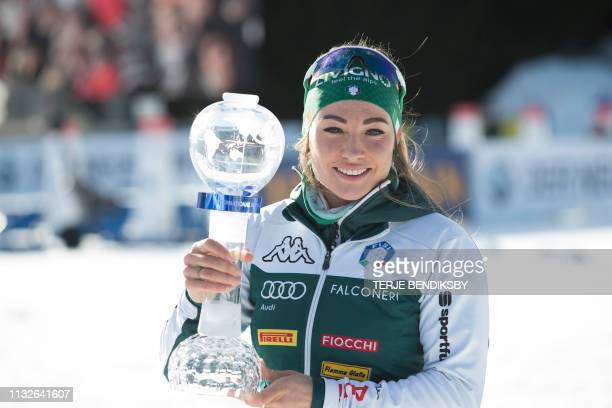 Italy's Dorothea Wierer poses with the IBU World Cup biathlon overall trophy after the Mass start event at IBU Biathlon World Cup in Oslo on March 24...