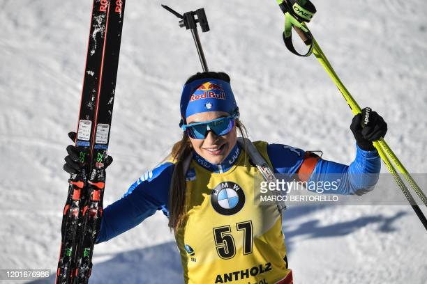 Italy's Dorothea Wierer reacts after crossing the finish line of the IBU Biathlon World Cup Women's 15 km Individual Competition in RasenAntholz...