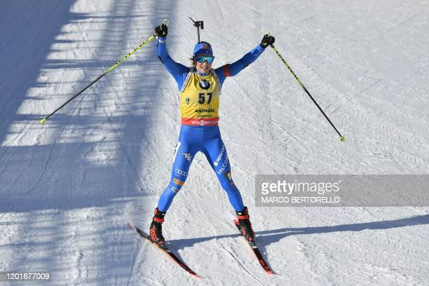 Italy's Dorothea Wierer reacts as she crosses the finish line of the IBU Biathlon World Cup Women's 15 km Individual Competition in RasenAntholz...